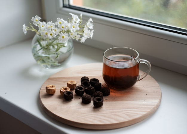Chinese puer tea in cup on window, traditional chinese pressed puerh
