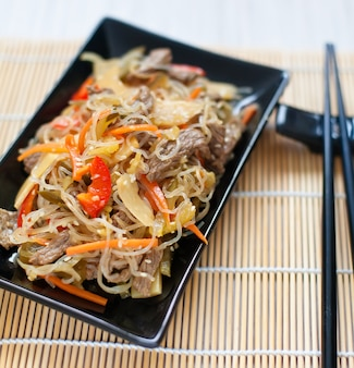 Chinese rce noodles with meat and vegetables