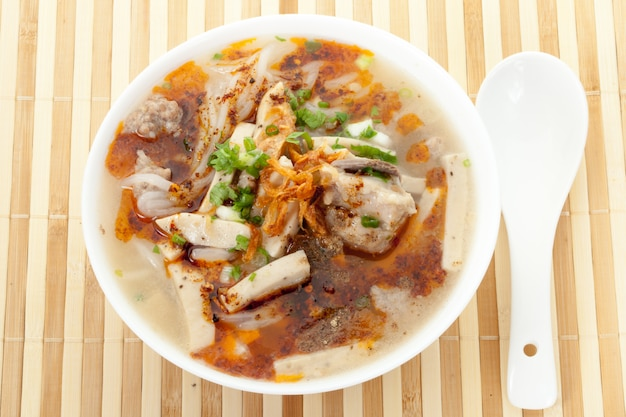 Chinese roll noodle soup,boiled chinese pasta square,paste of rice flour.