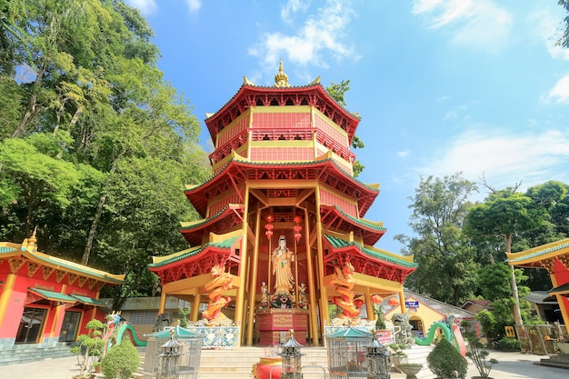 Chinese style pagoda with a giant statue of guan yin or goddess of compassion and mercy at tiger cave temple (wat tham seua) in krabi, thailand.