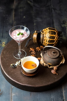 Chinese tea garnished with star anise, served with blackberry pudding