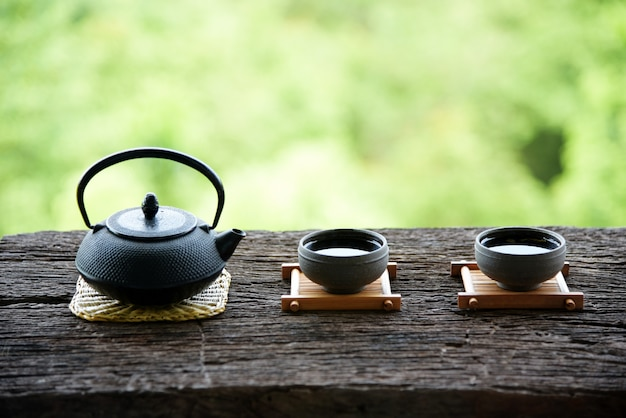 Chinese tea set oriental drink style on natural green