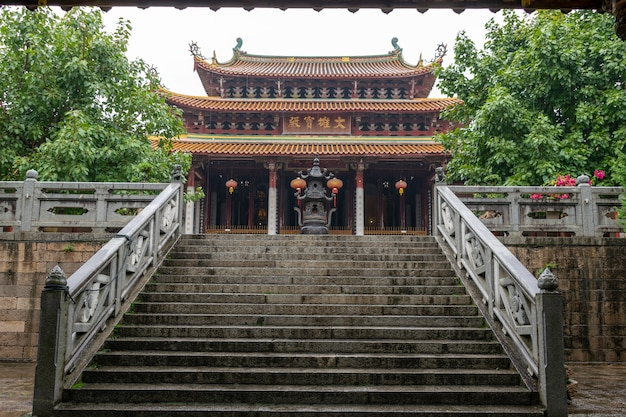 Chinese traditional buddhist architecture in the rain, the plaque reads