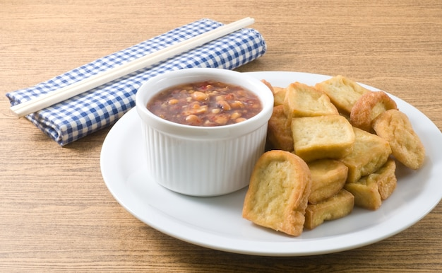 Chinese traditional deep fried tofu or fried bean curd served with sweet
