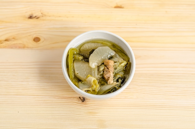 Chinese vegetable stew, mixture of vegetables and pork on wooden background