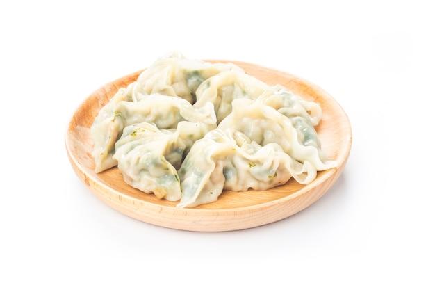 Chinese vegetables dumplings on white