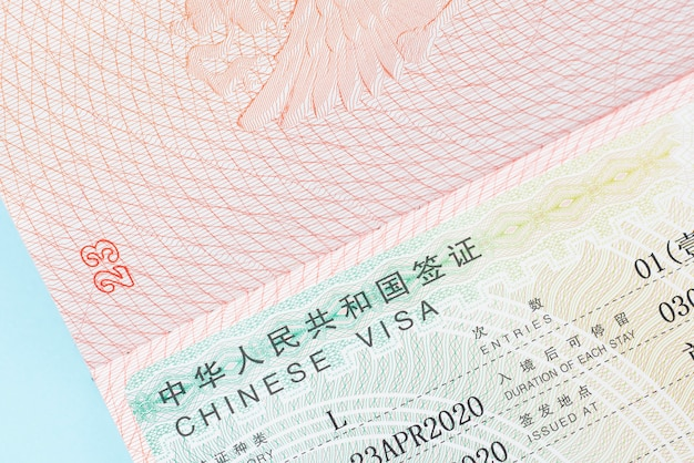 Chinese visa in a foreign passport close-up, copy space.