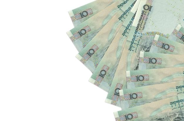 白い表面に置かれている中国人民元紙幣