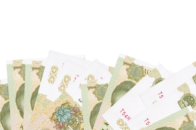 Chinese yuan bills laying on white surface