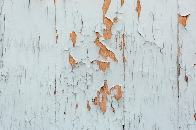 Chipping paint on worn wooden surface
