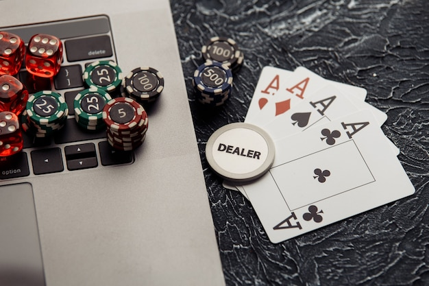 Chips, dices and playing cards for poker online or casino gambling.