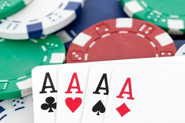 Chips and four aces of a kind poker