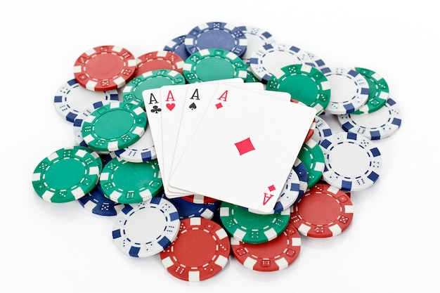 Chips and four aces of a kind