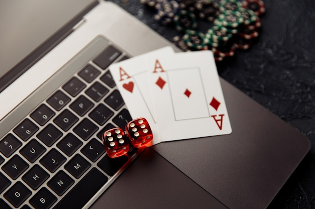Chips red dices and playing cards with aces for poker online