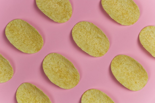 Chips rows pink pastel background