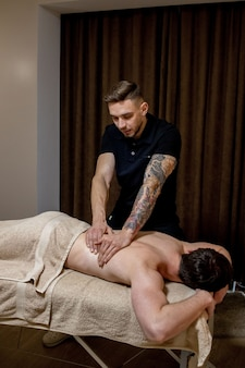 Chiropractic, osteopathy, manual therapy, acupressure. therapist doing healing treatment on man.