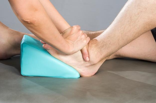 Chiropractor doing a feet massage