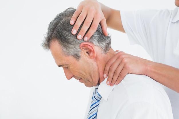 Chiropractor doing neck adjustment