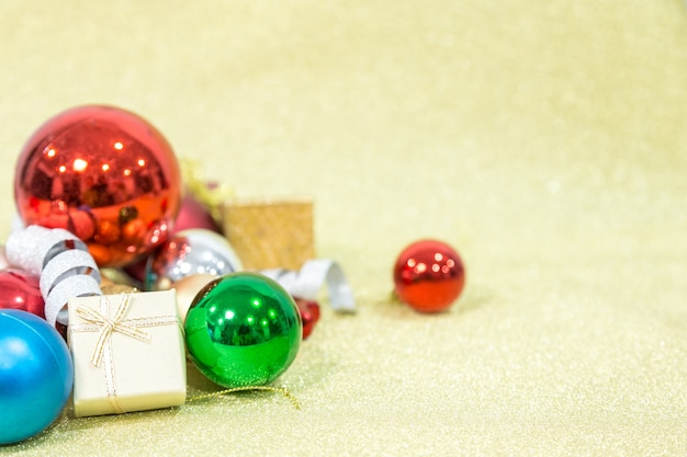 Chirstmas ball on gloden background for celebration and festival. copy space.