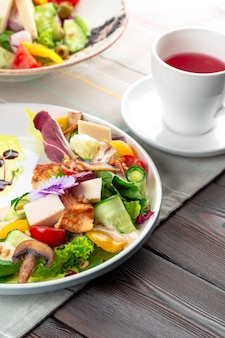 Chisken breast and mushroom salad with vegetables