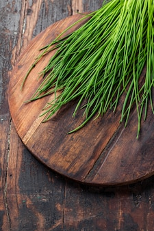 Chives on wooden board