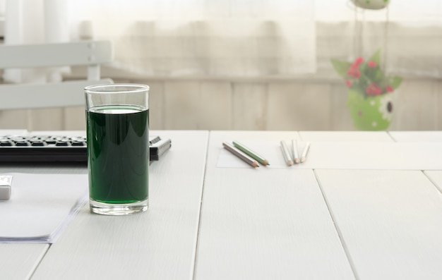 Chlorophyll in glass on table