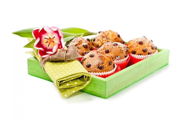 Choc chip muffins in a wooden tray