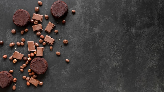 Chocolate assortment on dark background with copy space