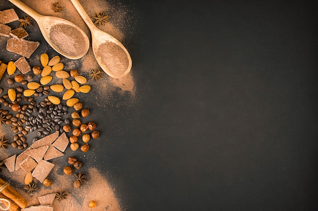 Chocolate background from different types of nuts, chocolate slices, coffee beans and cocoa. copy space. banner.