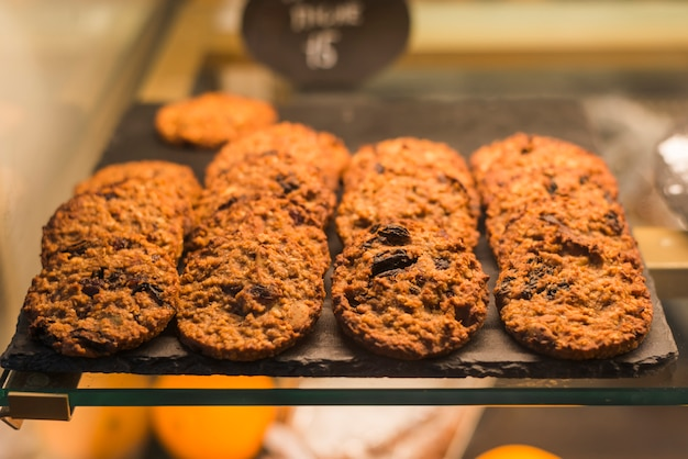 Chocolate baked oats cookies on rock tray in the display cabinet