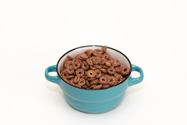 Chocolate balls corn flakes isolated with copy space background.