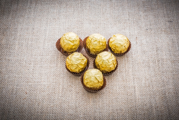 Chocolate balls wrapped in gold foil