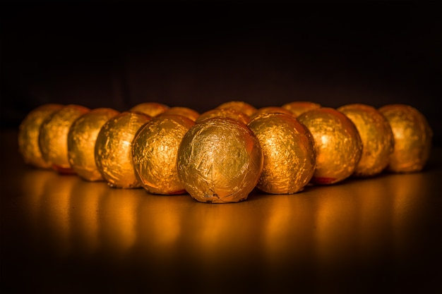 Chocolate balls wrapped in golden paper