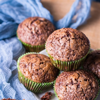 Chocolate banana muffins with sugar topping.