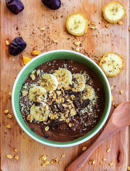 Chocolate banana smoothie with granola