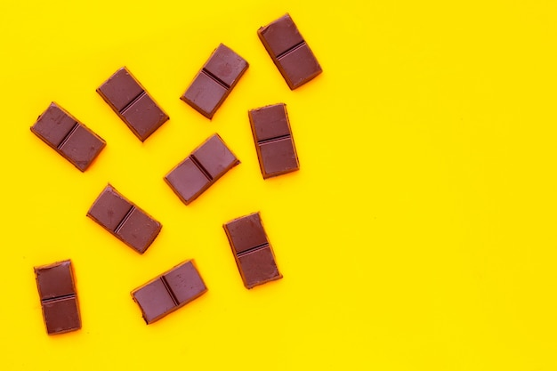 Chocolate bar isolated on yellow surface