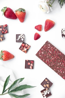 Chocolate bar with strawberry and elements vertical