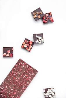 Chocolate bar with strawberry white background vertical