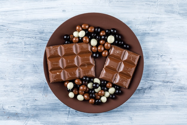 Chocolate bars with chocoballs in a plate