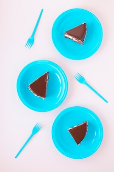 Chocolate birthday sliced cake on plates