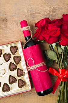Chocolate bouquet of roses and red wine