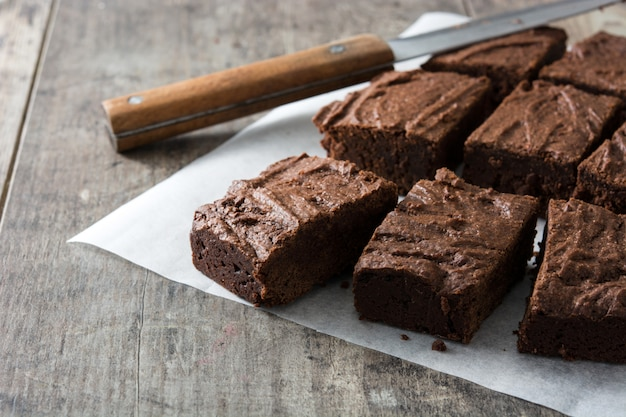 Chocolate brownie portions on wooden