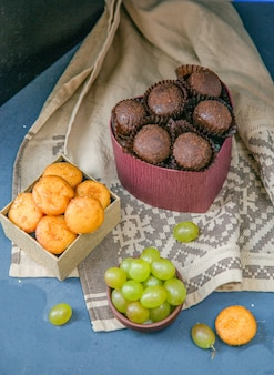 Chocolate buns and cookies with grapes.