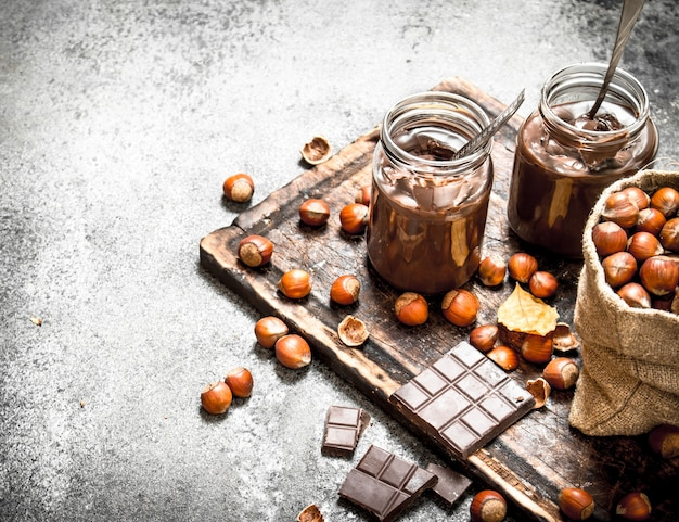 Chocolate butter with hazelnuts on rustic background