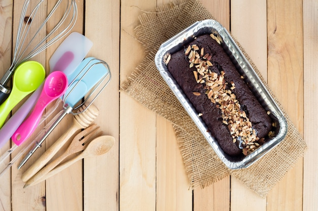 Chocolate cake in aluminum foil box packaging and bakery equipment,top view.