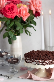 Chocolate cake and bouquet of roses candles