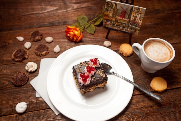 Chocolate cake cup coffee on festive wooden table