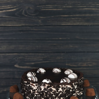 Chocolate cake in front of wooden blackboard