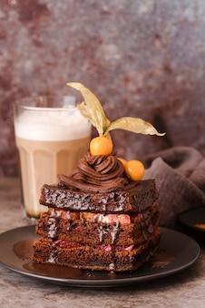 Chocolate cake on plate with chocolate milk