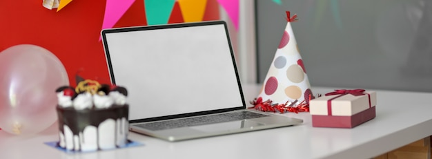 Premium Photo Chocolate Cake And A Present Near Laptop